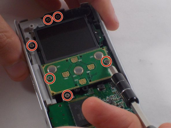 Remove the six 1mm screws with the 1 Phillips head screwdriver.