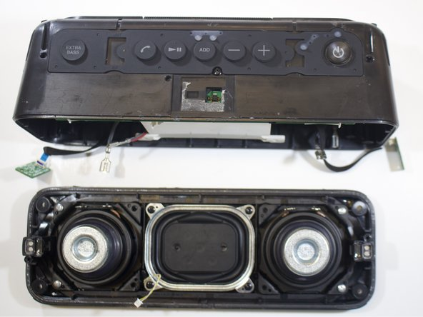 Separate the speaker lid entirely from the bottom frame.