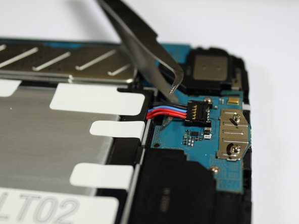 Image 2/3: Once the battery is removed, it should look as it does in the third picture.