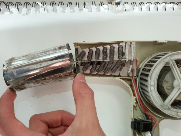 Remove the heat-element housing by sliding it off of the dryer.