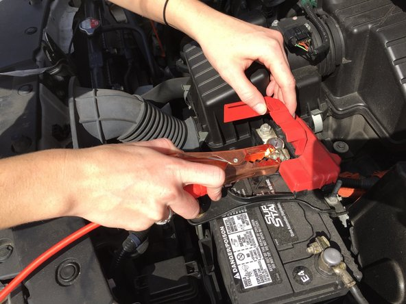 Attach the other RED lead to the positive (RED) terminal of the dead car's battery.