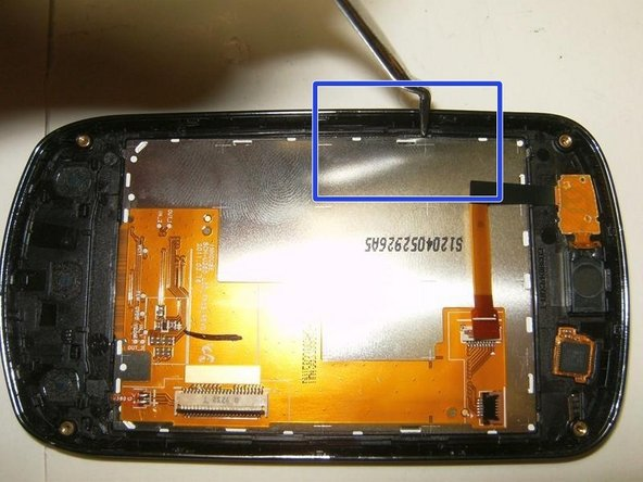The LCD is glued to the front case. Use a pick or similar to release the LCD.