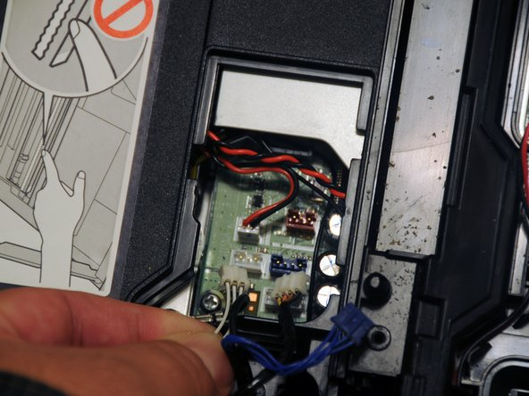 Remove the three power cables that connect the scanner to the motherboard.