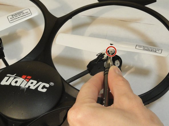 Using  a #PH000 screwdriver, remove the 5mm screws retaining each propeller to the rotating post.
