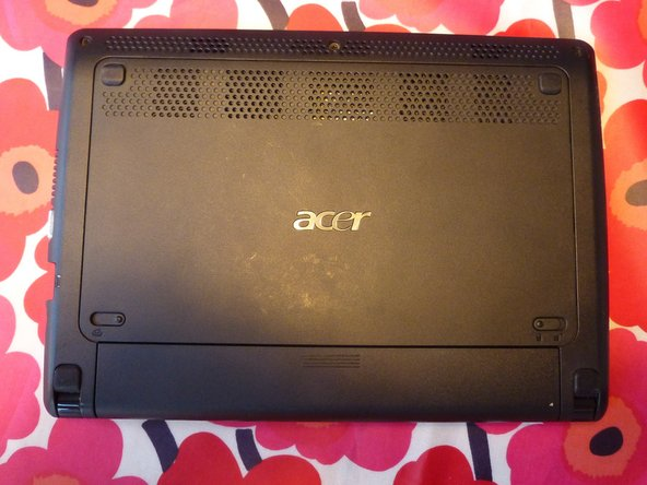 Put the netbook, so the back side is upwards.