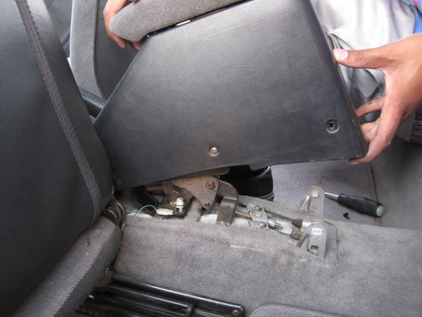 Remove the rear portion of the center console.