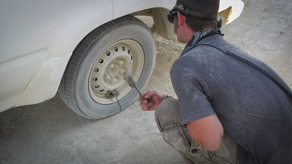 Car repair while driving in the desert