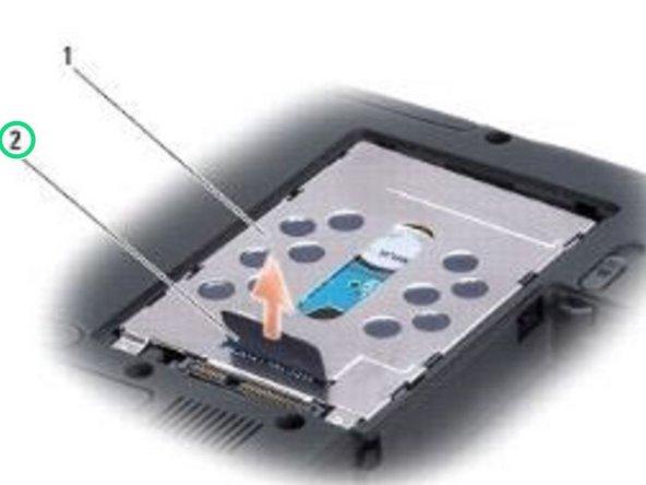 Retire el conjunto del disco duro con la pestaña de extracción.
