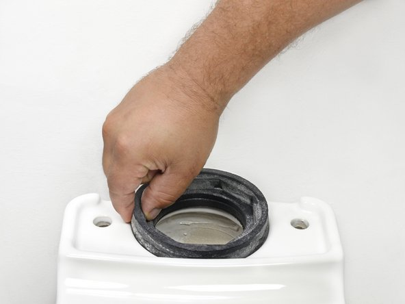 Remove the tank to bowl gasket from the  opening at the top of the toilet bowl.