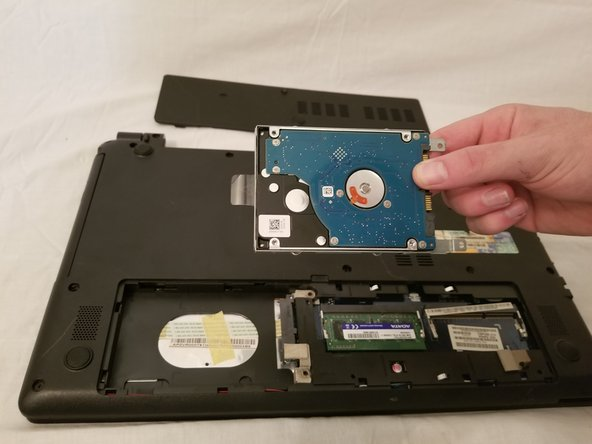 The hard drive will slide to the left, allowing it to be safely removed.