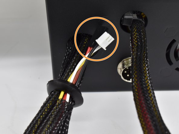 With the grommet loose, you can feed harness A through the grommet with the 2 and 3 pin connector going first.