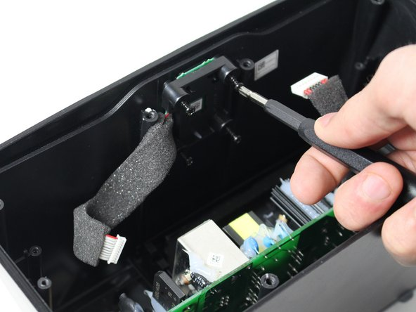 Image 3/3: You may need a special screwdriver to remove the bottom two screws.  We used the flexible shaft attachment from our iFixit 54 Bit Driver Kit