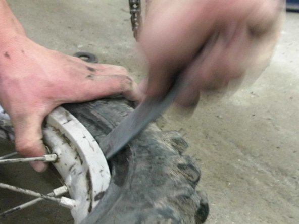 Now do the same method of leverage, but put the tire back on.( Be extremely careful to not pinch the tube between the tire spoon and the rim.)