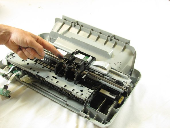 Image 1/2: Using both hands, carefully lift the  ink cartridge track off of the main body of the printer.