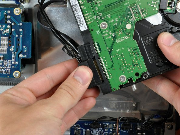 Image 2/2: Pull the SATA power connector away from the hard drive.