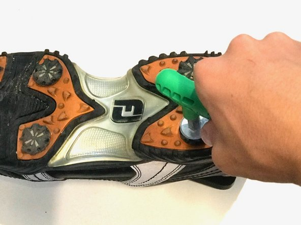 Remove each golf shoe spike using the Softspikes Ripper Wrench by placing the wrench in the grooves of the spike and turning it counterclockwise.