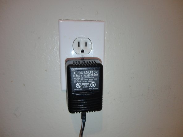 Check to make sure that the power cord is connected to an outlet. If not, take the two-pronged end and plug it in to an outlet. The device is now correctly plugged in.