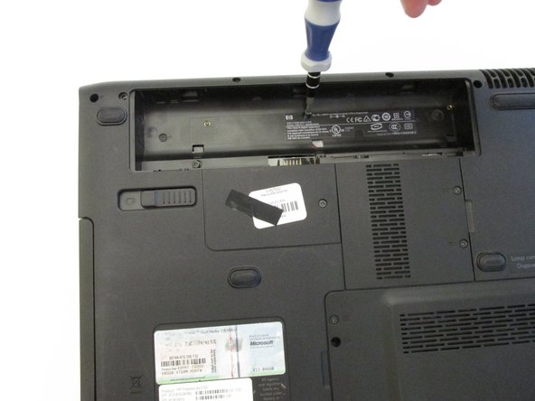 Remove the ten 8.9mm screws (underneath where the battery would be) holding the keyboard and bezel in place.