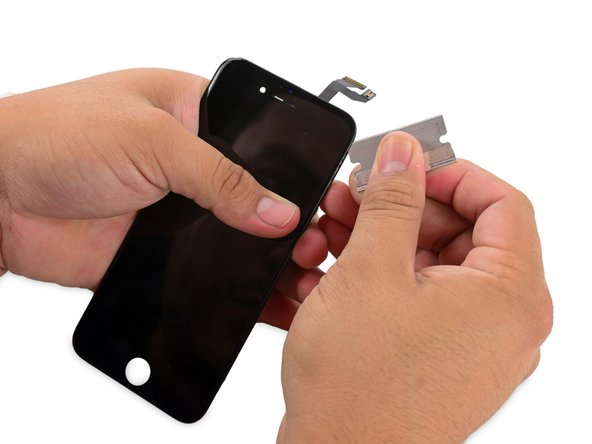 First to fall: The plastic mounting frame containing the clips that secure the display to the body of the iPhone. (Try saying that five times fast.)
