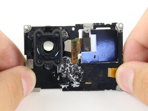 Separate the LCD assembly by pulling away the motherboard.