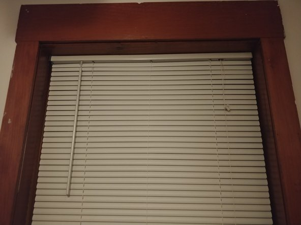 Make sure the blinds lower equally without catching on anything.