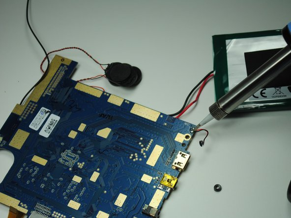 Lift up the motherboard and use a soldering station to remove the microphone from its wires.