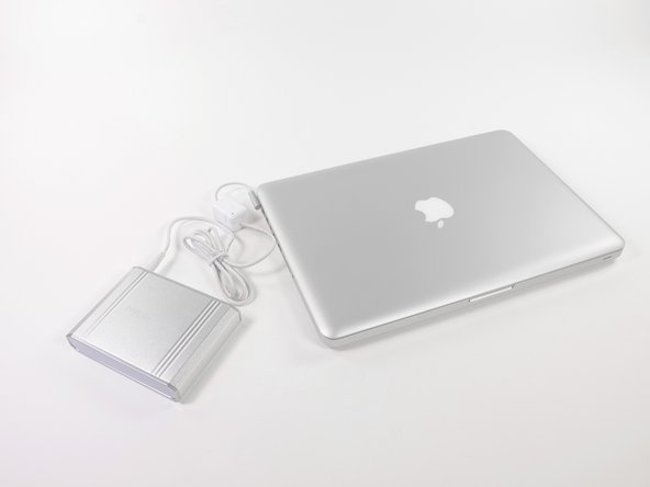 Use the modified MagSafe Cable to power and recharge your MacBook with HyperJuice external battery. The LED light on the Small Magic Box will light green during use.