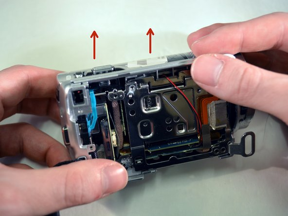 Image 1/2: Set the top case panel aside./'''Set the device aside.'''