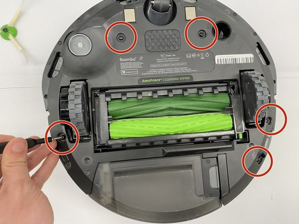 Using a Phillips #1 screwdriver, unscrew the 5 screws surrounding the bottom cover of the Roomba