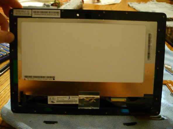 The screen is only held on with some adhesive so (CAREFULLY) pry them apart. Using a heat gun to loosen the adhesive is HIGHLY recommended to avoid cracking the LCD while separating. The adhesive runs around the entire LCD frame. It's the adhesive that holds the LCD to the digitizer, not the metal frame. Try not to pry against the screen.