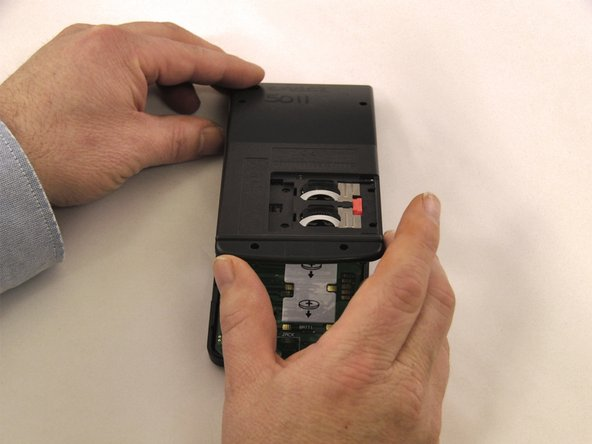 Image 3/3: Start prying from the bottom of the calculator, as the case hooks into the top.