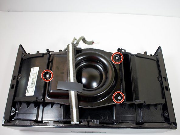 Remove the three 19 mm PH2 screws holding the metal subwoofer cover down.