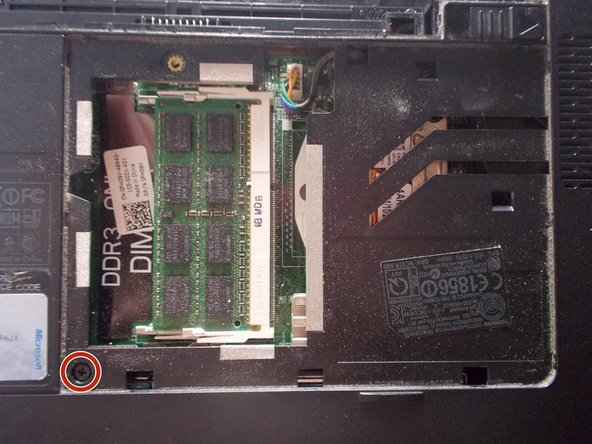Unscrew the 2.5x5 mm screw inside the RAM compartment.