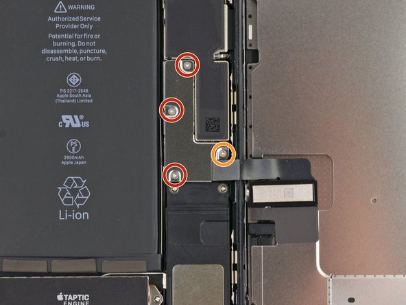 Remove the following four tri-point Y000 screws securing the lower display cable bracket to the logic board: