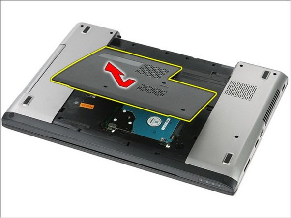 Lift the access panel up at an angle and remove it from the computer.