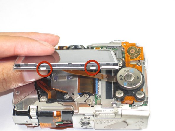 In order to remove the LCD from its mount, carefully pry up the four tabs along the top and bottom edges of the screen.
