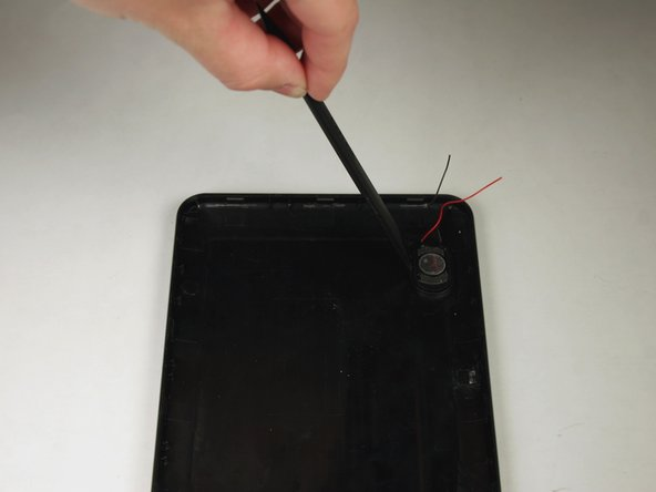 Insert the flat end of the spudger between the casing and the speaker.  Push inwards to pry the speaker from the casing.
