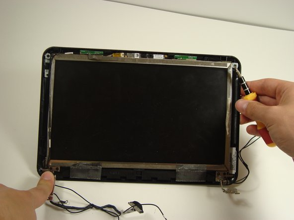 Disassembling Compaq Mini 110 Display Assembly