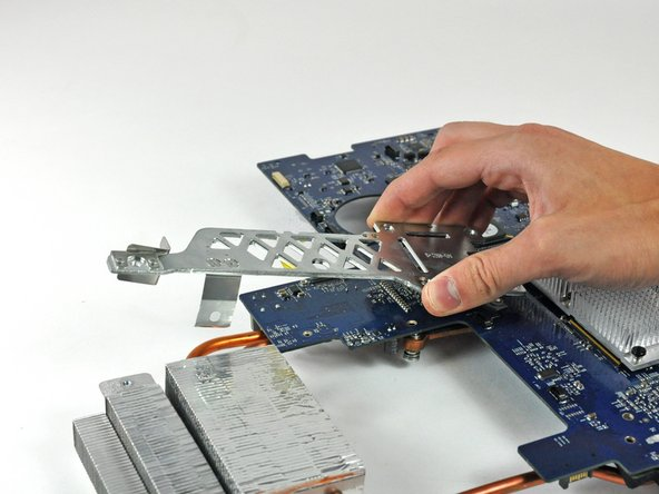 Carefully lift both metal heat sink brackets off the logic board.