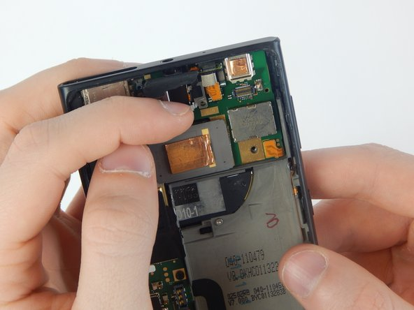 Remove the  headphone jack by pulling back on the silver plate with your fingernail.