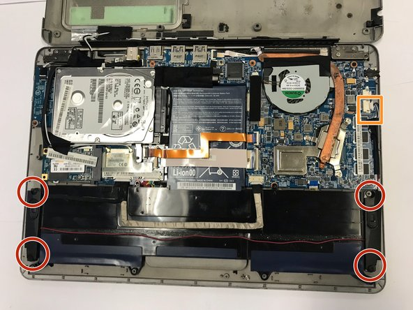 Remove the four Phillips #0 screws that are connected to the left and right speakers.
