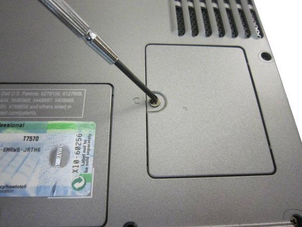 Remove the 3.9mm screw with a Philips #1 screwdriver containing the modem.