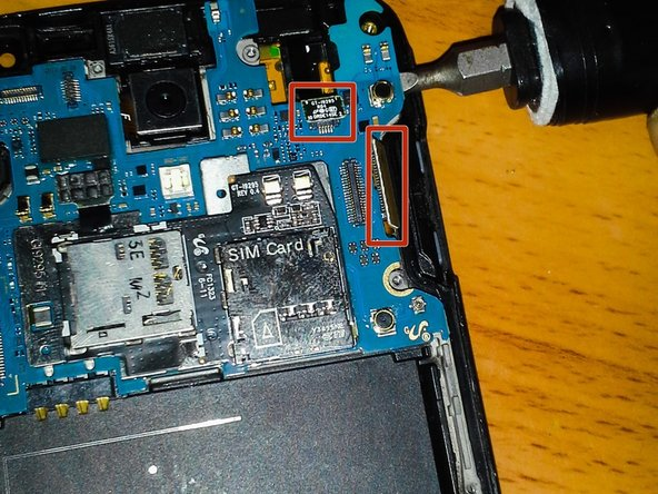 One side at a time, GENTLY pry the motherboard from the phone.