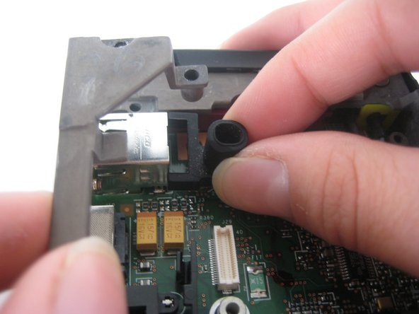 Image 1/1: Remove the rubber microphone cover in the upper left hand corner by lifting up the gray metal frame.