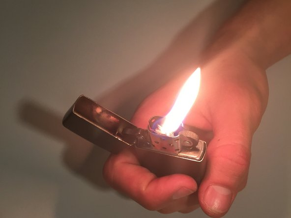 Image 1/1: Be sure not to spark the lighter while it is out of the case, since closing the case is typically how the flame is put out.