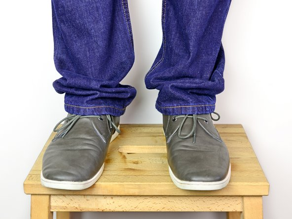 While wearing your jeans, have a friend help you fold the cuffs of each pant leg to your desired length.