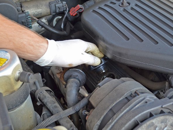 Remove the oil filler cap by turning it counter-clockwise and lifting it off of the valve cover.