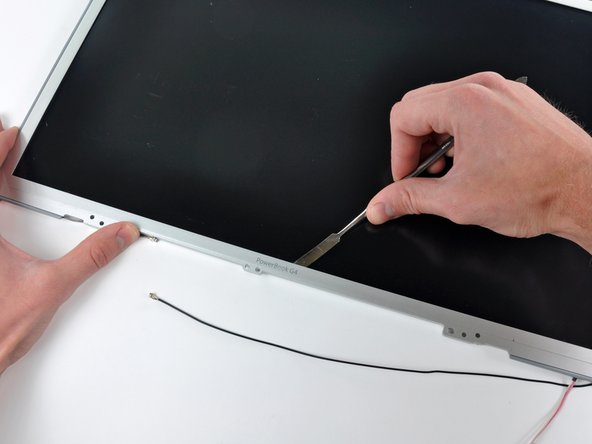 Continue running the edge of your metal spudger between the LCD frame and the front bezel until the right, bottom, and left sides of the LCD are free.