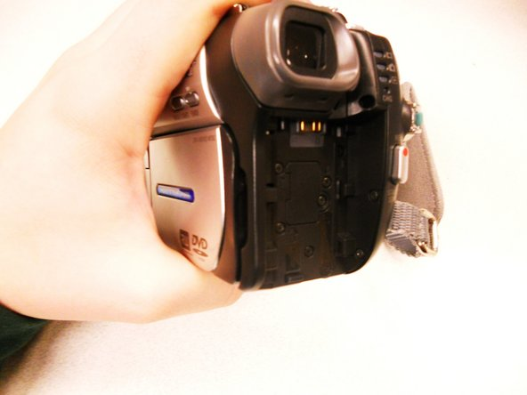 Slide the battery out of the back of the camera.