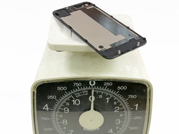 Image 3/3: Using a high tech, advanced precision scale, we conclude that the entire rear case of the iPhone 5 weighs only slightly more than just the glass rear panel of the 4S.